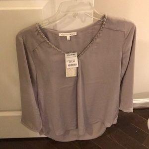 Beige/tan/grayish blouse with beaded neckline